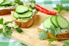 Crispy toast with goat cheese and cucumber Stock Images
