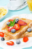 Crispy toast with honey, fresh berries, cup of coffee, juice Royalty Free Stock Photography