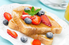 Crispy toast with honey, fresh berries, cup of coffee Royalty Free Stock Photo