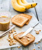 Crispy toast with peanut butter, bananas, breakfast Stock Photography