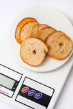 Crispy toasted toast on the kitchen digital scale Stock Images