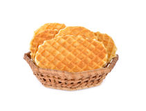 Crispy waffle with butter flavour in the basket and on white bac. Crispy waffle with butter flavour in the basket and on a white background Royalty Free Stock Image