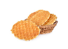 Crispy waffle with butter flavour in the basket and on white bac. Crispy waffle with butter flavour in the basket and on a white background Stock Photos