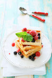 Crispy waffles and fresh berries Stock Photography