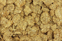 Crispy wheat flakes background Royalty Free Stock Photos