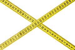 Criss-cross measuring tape Royalty Free Stock Photos