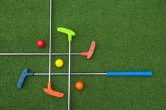 Criss Cross of Mini Golf Clubs stock photography