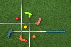 Free Criss Cross Of Mini Golf Clubs Stock Photography - 117605942