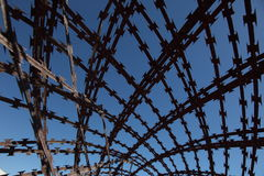 Criss crossed barbed wire Royalty Free Stock Photography