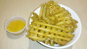 Crisscross Fries. With cheese dip stock photography
