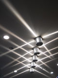Crisscrossing Light beams on ceiling Royalty Free Stock Images