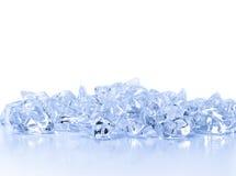 Cristais transparentes do gelo em um fundo claro Fotografia de Stock Royalty Free