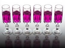 Cristal com líquido cor-de-rosa Fotos de Stock