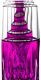 Cristal con el líquido rosado Fotos de archivo