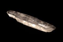 Cristal de quartzo sobre o preto Foto de Stock Royalty Free