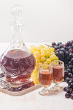 Cristal glasses and a carafe of liquor Royalty Free Stock Photography