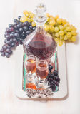 Cristal glasses and a carafe of liquor Stock Image