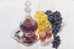 Cristal glasses and a carafe of liquor Stock Photos