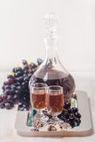 Cristal glasses and a carafe of liquor Stock Images