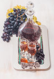 Cristal glasses and a carafe of liquor Royalty Free Stock Images