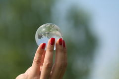 Cristal globe. In hands Royalty Free Stock Photography
