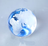 Cristal globe of the Earth on a Computer Royalty Free Stock Photography