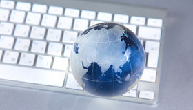 Cristal globe of the Earth on a Computer Stock Images