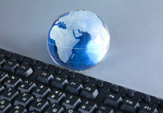 Cristal globe of the Earth on a Computer Royalty Free Stock Images