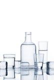 Cristalería con el líquido transparente Imagen de archivo libre de regalías