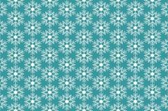 Cristales de hielo de los copos de nieve en fondo de la turquesa Imagen de archivo libre de regalías