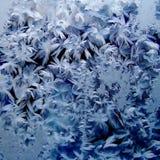 Cristales de hielo sobre el vidrio Foto de archivo libre de regalías
