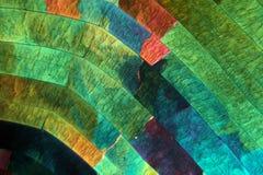 Cristales del azufre debajo del microscopio Foto de archivo