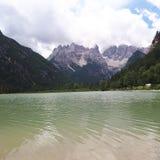 Cristallo, lake, mountainous landforms, mountain, water. Cristallo is lake, water and mountain range. That marvel has mountainous landforms, wilderness and water Stock Image