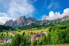 Cristalo ridge and green meadows in Dolomites Royalty Free Stock Images