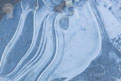 Cristaux de glace de texture sur le fond de route Images libres de droits