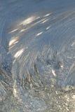 Cristaux de glace sur Glass.130 Photographie stock libre de droits