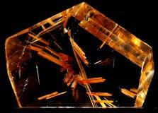 Cristaux de rutile compris dans un cristal de quartz Photographie stock