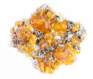 cristaux jaunes crus de spessartine de grenat sur le blanc photos stock
