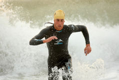 Cristian Cofine of Spain. In action finishing swimming at Barcelona Garmin Triathlon event at Barcelona beach on October 16, 2011 in Barcelona, Spain Stock Photos