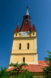 Cristian fortified saxon church tower. Transylvania, Romania royalty free stock photography