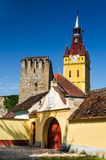 Cristian fortified saxon church, Transylvania, Romania. Cristian village, fortified saxon church built in romanic style, with gothic sculptural elements Royalty Free Stock Photos