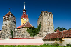 Cristian fortified saxon church, Transylvania, Romania. Cristian village, fortified saxon church built in romanic style, with gothic sculptural elements Stock Images