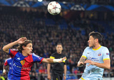 Cristian Tanase and Kay Voser pictured during UEFA Champions League game. Steaua's Cristian Tanase and FC Basel's Kay Voser  pictured during the UEFA Champions Royalty Free Stock Images