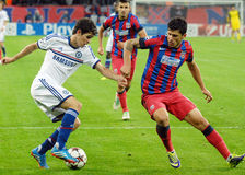 Cristian Tanase of Steaua and Oscar of Chelsea Stock Image