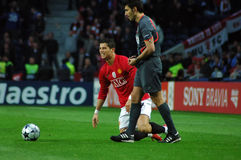 Cristiano Ronaldo (FIFA World Best Player 2009). Cristiano Ronaldo gets up after being tackled in the qualificationgame to the 2009 UEFA Champions League Semi Royalty Free Stock Image
