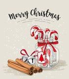Cristmas życie, cukierek trzciny w szklanych słoju, cynamonu i dźwięczenia dzwonach z tekstów Wesoło bożymi narodzeniami, ilustra Zdjęcia Royalty Free