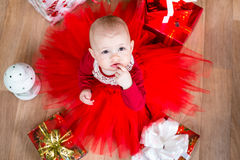 Cristmas baby with gifts. Top view of cristmas baby with gifts royalty free stock images