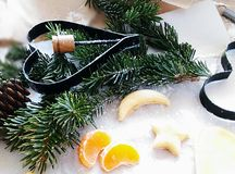 Cristmas bakery. Cristmas mood wit fir tree brunches, cookies and tangerins Stock Photo