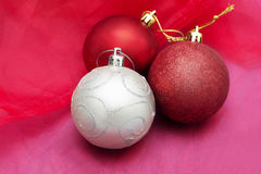 Cristmas balls decoration ornament on red cloth background Royalty Free Stock Images