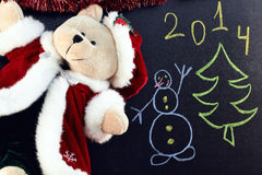 Cristmas  bear on a chalkboard Royalty Free Stock Photos